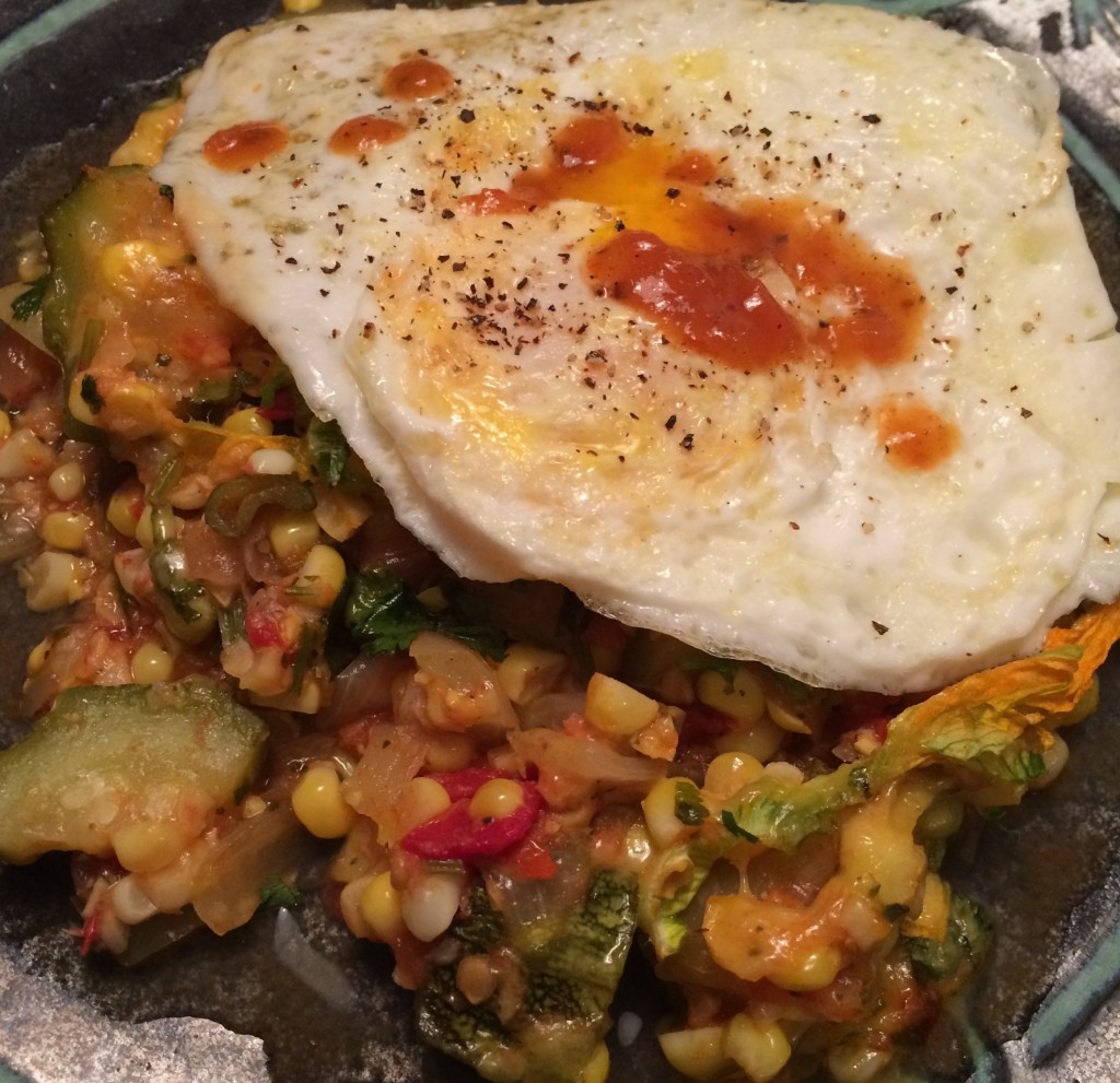 Calabacitas makes a complete meal topped with a fried egg